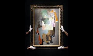 Christie's employees hold 'Instruments de musique sur un gueridon' by Picasso, January 2009