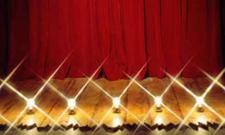 Red stage curtain and footlights