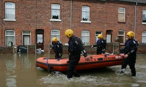 Firefighters in Yorkshire search homes in a flooded village