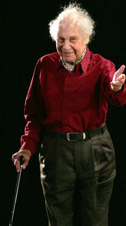 Merce Cunningham salutes the crowd on stage after a show in Paris in 2005