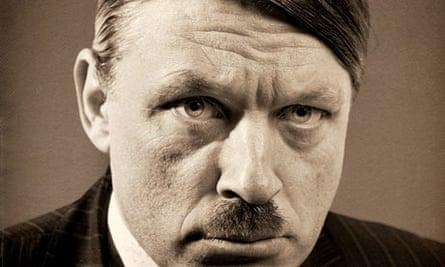 Comedian Richard Herring wearing a Hitler moustache