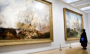 A visitor compares Turner's Battle of Trafalgar with Loutherbourg's The Glorious First of June