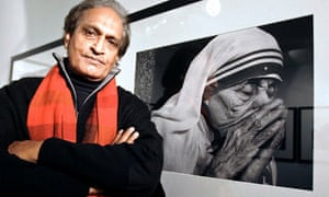 Raghu Rai poses next to his photograph of Mother Teresa in Madrid