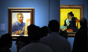 Visitors stand in front of a self-portrait by Van Gogh at the Royal Academy