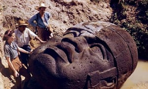 Archaeologists marvel at a monumental Olmec stone head dug up at La Venta, Mexico in 1947