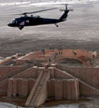 A US army helicopter flies over the stepped Ziggurat temple