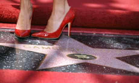 Cameron Diaz poses on her star on the Walk of Fame on Hollywood Boulevard