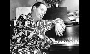 Composer Cole Porter sitting at a piano