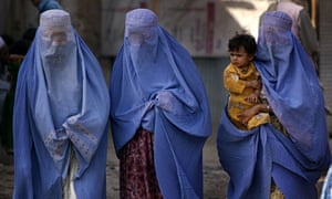 Burqa-clad Afghan women at a camp for refugees in Pakistan