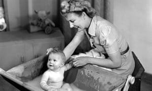 Woman bathing a baby, 1948.