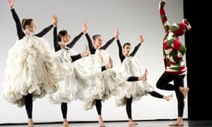 Merce Cunningham: dancers in big white frocks face one with a jumper pulled over his head