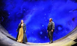 Claire Rutter and Gwyn Hughes Jones on a curved ramp with a starry background