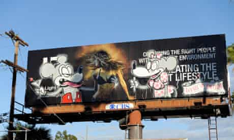 Sign of the crimes ... the Light Group billboard poster allegedly tagged by Banksy.