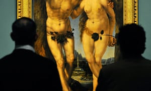 Visitors view a detail of Adam and Eve by Jan Gossaert at the National Gallery in London