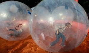 Children play in 'walking water balls'