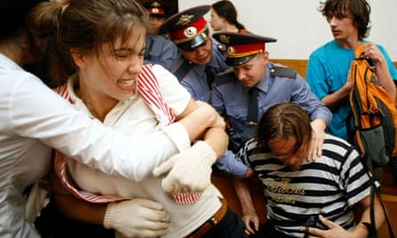 Voina protesters struggle with police at a 2009 court hearing