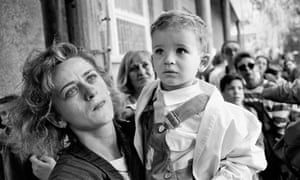 Tom Stoddart's shot of a mother evacuating her son from Sarajevo in 1992