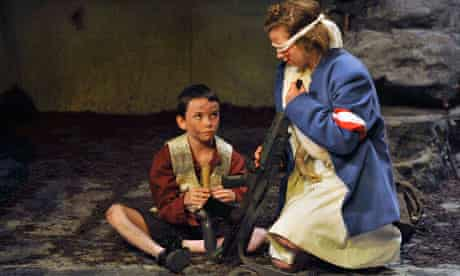 The Wheel: A blindfolded girl holds a gun, while a smaller boy watches