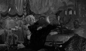 Jennifer Saunders as a heavily made-up Margaret Thatcher reclining on a divan