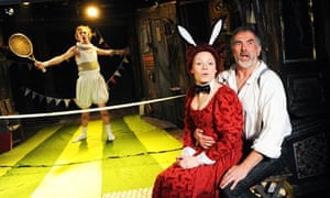 Wittenberg: Hamlet brandishes a tennis racket and a woman in bunny ears sits on Dr Faustus's knee