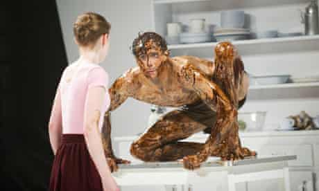The Metamorphosis: A dark goo-covered Edward Watson crouches on a table as Laura Day watches