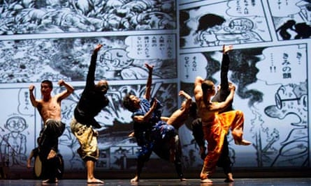 Five shadowy dancers strike kung fu poses in front of giant manga screen