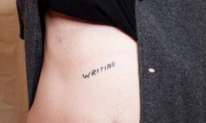 Adrian Searle displays his tattoo by artist David Shrigley.
