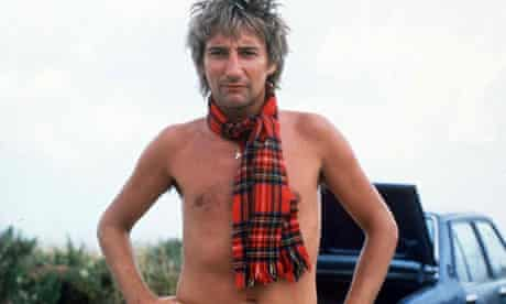 Singer Rod Stewart wearing just a tartan scarf