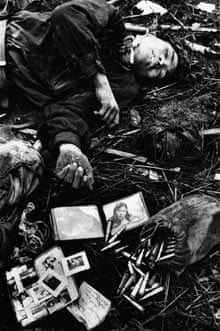 A dead North Vietnamese soldier and his plundered belongings, Hue, 1968