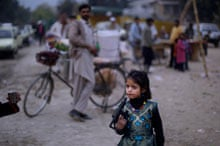 Pakistani girl plays with a toy gun