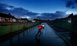 Schoolboy running across street