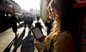 European commission and apple reach settlement over ebook price woman reads ebook kindle in street fandeluxe Images