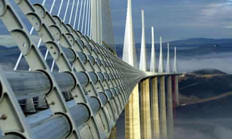 Pillars from the Millau Viaduct rise above clouds over the river Tarn in France
