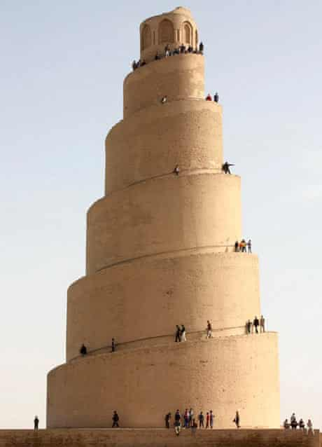 Local residents visit the Spiral Minaret of the Great Mosque in Samarra