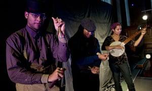 Carolina Chocolate Drops' Dom Flemons and Hubby Jenkins on bones and Rhiannon Giddens on banjo