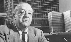 Model architect … Mies van der Rohe sits beside one of his designs.