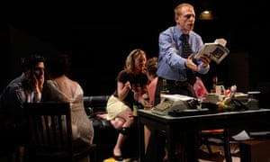Scott Shepherd (standing) reads the novel on stage