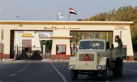 Egyptian military truck passes in front of Rafah border crossing gate in Al Arish