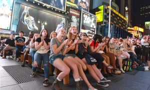 Fans in Times Square watching the Tony awards on a live relay.