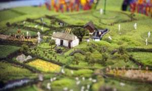 Model of London's Olympic Stadium transformed into rural scene for opening ceremony