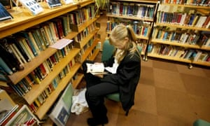 Pupil in a school library