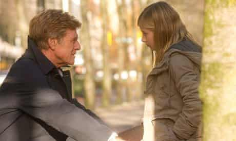Robert Redfordand Jackie Evancho in a scene from The Company You Keep