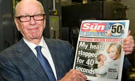 Rupert Murdoch with first issue of the sun on sunday