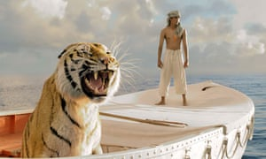 Suraj Sharma as Piscine Molitor Patel adrift with the Bengal tiger, Richard Parker