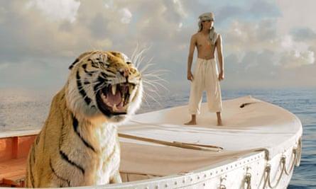 Suraj Sharma as Piscine Molitor Patel adrift with the Bengal tiger, Richard Parker