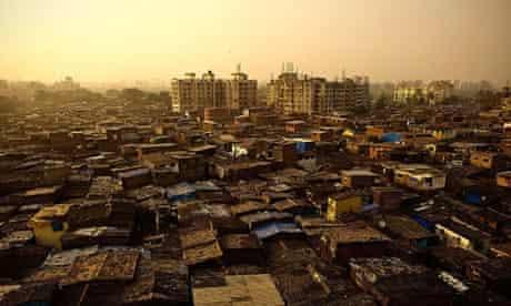 The sun sets over Dharavi slum in Mumbai, India.