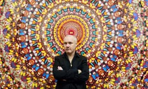 Forever young … Damien Hirst with a piece from his Doorways to the Kingdom of Heaven series.