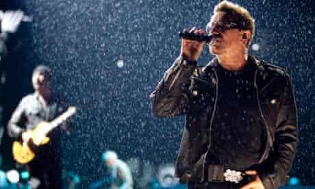 U2's Bono on stage in the raing at Glastonbury 2011