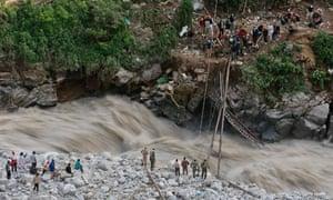 Soldiers repair bridge over River Alaknanda Uttarakhand