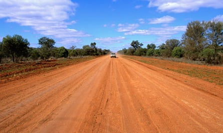 Car Approaching on Dirt Road